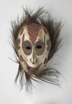 Mask   (20th century)    Artist/s name  Biwat people, Yuat River, Lower Sepik River, Papua New Guinea      Medium  wood, earth pigments, cassowary feathers  Measurements  54.5 x 11.2 x 40.0 cm  Place/s of Execution  Yuat River, Lower Sepik River, Papua New Guinea
