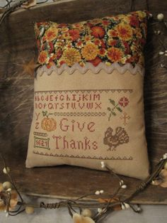 Hey, I found this really awesome Etsy listing at http://www.etsy.com/listing/163832923/primitive-cross-stitch-sampler-pillow