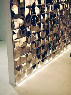 Gold mirrored bathroom tiles on my recent trip to Porcelanosa HQ