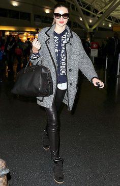 Miranda Kerr --- Sunglasses: Prada, $245; Shirt: Rag & Bone, $80; Cardigan: A.L.C., $385; Leather pants: Helmut Lang, $920; Bag: Givenchy, $2,405; Coat: Isabel Marant, $1,115; Sneakers: Isabel Marant, $640; Total: $5,790