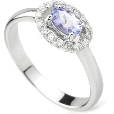 Tanzanite Oval and Diamond Halo engagement ring. Set with a 0.45cts Tanzanite, surrounded by a halo of round brilliant cut diamonds weighing 0.18cts.