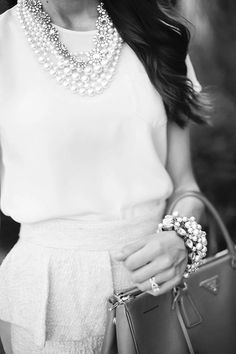 Peplum + pearls in black + white.