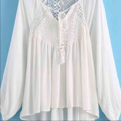 Boho white tassel lace top Fits all small sizes. No flaws or imperfections. The pic is dull but in real life the shirt is bright and pure white. Flowy lace comfortable blouse material Double Zero Tops