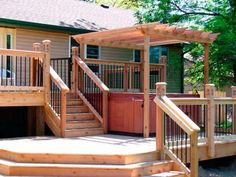 multi level deck with pergola -- see this is an awesome idea! And you just have the hot tub right below our first deck!