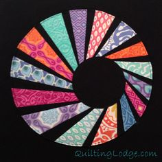 Swirling Dresden Block - i think this would be great as the whole quilt, not just one block.