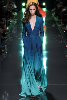 Elie Saab Spring 2015–Inspired by the sea, Elie Saab's spring-summer 2015 collection took the Lebanese designer's creations to new depths with ombre effects, water prints and even fish-shaped motifs. Silk cady gowns, lace fabrications and leisurely trousers brought a seventies vibe to the new season. Even spring's accessories are aquatic themed with blue and green …