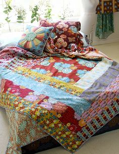 look closely...by anna maria horner modern log mansion...like a giant log cabin block,quilt size!! love, love,love!!