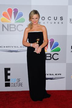 Amy Poehler posed with her Golden Globe at the end of her big night