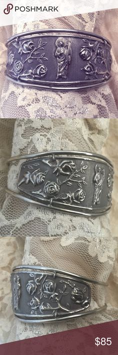 """Rare Sterling St Jude & Roses Shield Cuff Bracelet Rare to find design - Artisan made in Mexico - Beautiful repousse detail on a shield style cuff - The shield design in the front gives it a more fuller, wide cuff look - Not heavy weight at 12.6 grams but still a beautiful and unusual design with the Saint & Roses design - The inside measures about 6-1/4"""" plus there is a 1"""" opening - My wrist is about 7-1/8"""" around and it is a good fit - Marked 925MEX - It's vintage and will show some patina…"""