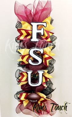 A personal favorite from my Etsy shop https://www.etsy.com/listing/474600593/fsu-garlanddeco-mesh-wreathgold-and