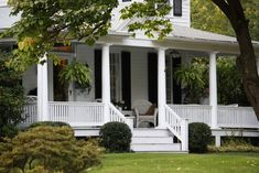 There it is! The perfect White Country House with a humongous porch!