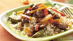 Quick Beef Tips and Vegetables - INGREDIENTS: 1/4 lb beef boneless sirloin tip steak, cut into 1/2-inch cubes, 1 bag (12 oz) Green Giant® Valley Fresh Steamers™ frozen Asian style medley 2 teaspoons water, 1 tablespoon stir-fry sauce with garlic and ginger, 1/2 cup uncooked instant white rice, 1/2 cup water.