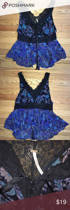 Free People Black &a Blue Floral Cami Women's size 4 New With Out Tags. Corset style hook and eye Closures for ease of dress. Deep Blue tones with Black looks stunning. Semi Sheer so pair with cami/Bralette. Free People Tops Tank Tops