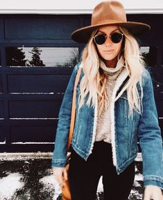 black jeans beige turtleneck sweater denim jacket hat