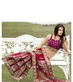 Lehenga style sarees bring two traditional Indian dresses together to create a fashion that draws attention that it very rightly deserves. These sarees allow women to become the focal point in any occasion. Lehenga Style Saree, Lehenga Saree, Indian Party Wear, Indian Bridal Wear, Indian Dresses, Indian Outfits, Indian Clothes, Wedding Sari, Wedding Reception
