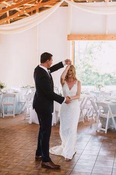 Barn reception, white reception, wood floors, white chairs, barn wood, september wedding, wedding inspiration, dark suit, anne barge bride