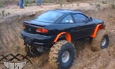 chevy cavalier mud car .. LOL! The guys can get right on this