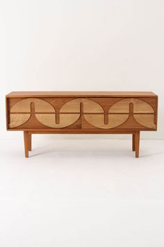 This buffet is called the Bluhm Credenza and is available at Anthro for a mere $3500.  A beautiful addition to any Mid-century modern dining room though...