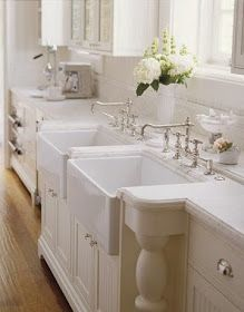 LOVE! White on white kitchen... Dual sunken ceramic farmhouse style sinks, stainless steel swing arm faucets, tile backsplash, marble countertops, beadboard cabinets. ♥ Susan Dossetter Design. #Home #Remodel #Architecture