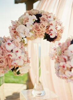 I like the idea here, rows of different colored flowers with a couple of accents thrown in, all in a tall vase.