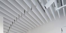 Optima Baffles from Armstrong Ceiling Solutions. High performance acoustical baffles, two standard dimensions, easy alignment and installation.