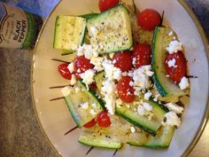 Grilled zucchini and cherry tomatoes with quinoa; yummy vegetarian meal!