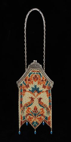 Evening purse, 1915-30, love the little blue beads on the  points