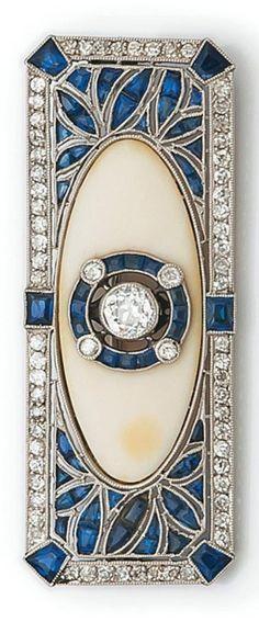 An Art Deco platinum, diamond, ivory and sapphire brooch. 5cm long. #ArtDeco