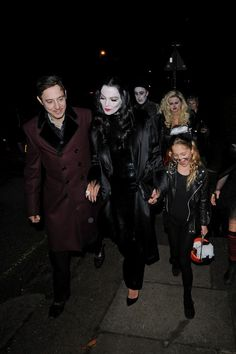 Kate Moss and husband Jamie Hince dressed as Gomez and Morticia with Kate Moss' daughter Lila Grace going to a Halloween party, October 31st  Kate is wearing the dress she wore when she went to the Golden Globes in 1995 with Johnny Depp