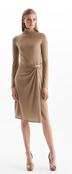Italian cashmere from Ralph Lauren Collection: this chic camel dress gathers around a bold horn ring at the waist for safari-inspired sophistication and a flattering fit. Enhance its effortless elegance by wearing it with neutral-hued sandals.