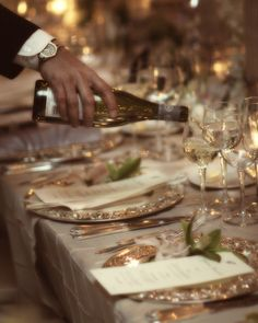 David Tutera wedding decor, romantic elegance - like the color of the tablecloth and the silver chargers