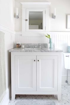 Suzie: Papyrus Home Design - Cottage bathroom with glossy white beadboard walls backsplash, ...