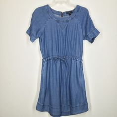 "J. Crew chambray denim dress size XS This J. Crew chambray dress is a medium wash. Zipper in back. Draw string elastic waist. Bust is about 34"". Hips is about 38"". J. Crew Dresses"