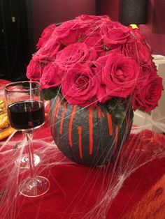 Cool Idea to use Pumpkins as a vase - Vampire-Inspired Halloween Decor on a Budget