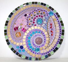 Mosiac with gold spiral and flowers // purple background // on round board // 33 cm diameter // on Etsy, $200.00