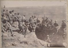 Photograph of soldiers on ridge - South African War, [19--] Reference Number: MS-Papers-0522-1/4/1-107 Photograph one of three photographs on page 107 of scrapbook. A caption in the scrapbbok accompanies the photograph but is indecipherable - possibily refers to the three numbers inked onto the print NEW ZEALAND Digitised Image Armed Conflict, British Colonial, New Zealand, South Africa, African, War, History, Caption, Soldiers