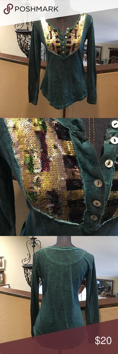 "FP Sequined Top Free People Sequined Top. No label so no guarantee of size. Measures 18"" from armpit to armpit. Length 23"" from top to bottom. Green distressed with multicolored sequins. Used great condition. ❌No Trades❌ Proceeds go towards feeding the homeless❌ Bundle to save, I have hundreds of items to choose from❌ Free People Tops Tees - Long Sleeve"