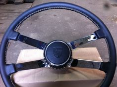 """Steering after rebuilt..new leather,blade with chrome,and brand new """"Hockey""""horn button..if you want,can you find it on ebay.(made by self)"""