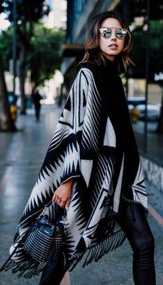Annabelle Fleur wears an edgy Aztec style blanket coat. Blanket Coat/Leggings/Sweater: Express.
