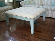DIY Upholstered Tufted Ottoman... I'll paint it in colors to go with the room (TBD)