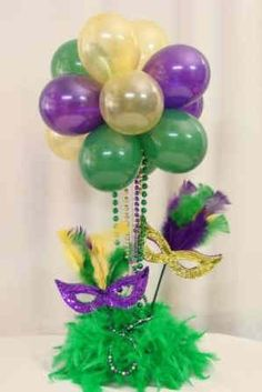 Gracie wants a Mardi Gras Birthday party this year. Cute Centerpiece.