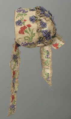 Antique child's brocade bonnet trimmed with silk violets