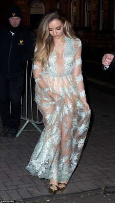 Make way: The birthday girl - who turned 23 on Boxing Day - went all out in a stunning sheer gown, complete with pale blue floral embroidery and a gaping neckline