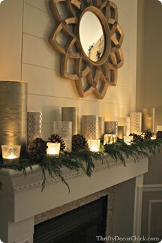 Elegant Christmas mantel made with wrapping paper and glass containers!