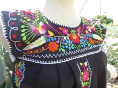Check out this item in my Etsy shop https://www.etsy.com/listing/251593634/mexican-hand-embroidered-peasant-dress