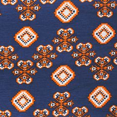 """Orange Cross Stitch on Navy Cotton Spandex Blend Knit Fabric - Lovely orange cross stitch look design on a navy blue back soft cotton spandex rayon blend knit.  Fabric is lighter weight with a nice drape and 4 way stretch.   Diamond measures 2"""".  ::  $6.50"""