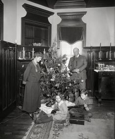 "Washington, D.C., circa 1922. ""Denby Christmas tree."" Junior remembers this as the best Christmas ever! His gun-giving dad is Secretary of the Navy Edwin Denby."