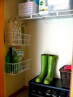 Baskets on the side.. Love!!  Keep small items off the floor.