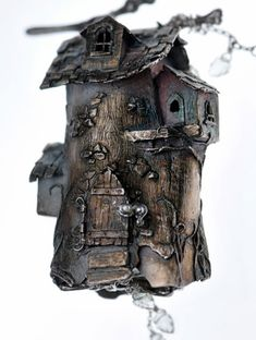 Fairy House - Hollow free formed house with opening door. Hung from my sterling branch and completed with aquamarine hand carved leaves. by Christi Anderson
