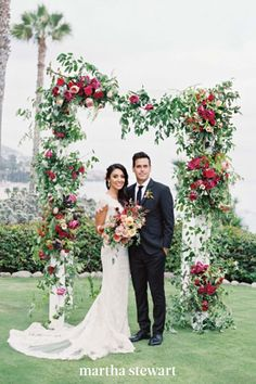 This simple floral arch was created with the help of drum roses, spray roses, raspberry scabiosa, and numerous vines and berries for a colorful ceremony backdrop. #weddingideas #wedding #marthstewartwedding #weddingplanning #weddingchecklist Wedding Ceremony Ideas, Simple Wedding Arch, Wedding Arch Rustic, Wedding Arch Flowers, Wedding Ceremony Arch, Floral Wedding, Wedding Arches, Ceremony Backdrop, Wedding Bride